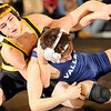 2-13-2010...103 lbs...River Dell's Brendan Campbell (top) appears to have the advantage but lost by a 5-2 decision to Mike Spadole of Wayne Valley.<br /> PHOTO: KELLY BIRDSEYE