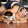 2-20-2010...112 lbs...Ramsey's Jeff Rottingen (top) wins a 30 second overtime ride-out defeating Tony Nadera of Paramus to win the District 5 championship at 112 lbs.<br /> PHOTO: KELLY BIRDSEYE