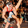 2-28-2010...135 lbs...Vinny Fava of  Elmwood Park (top) tangles with Zach Zotollo of Paramus in the Region 2, 135 lb championship winning 8-6 for first place.<br /> PHOTO: KELLY BIRDSEYE