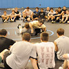 Lehigh College wrestling coach John Hughes (center top) demostrating a move with Lehigh College wrestler Mike Galante before a group that attended the fourth day of Mahwah High School wrestling coach Dave Heitman's wrestling clinic at Ramapo Ridge Middle School.<br /> PHOTO: KELLY BIRDSEYE