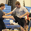 Don Bosco wrestler Joe Orrechio (left) working out with Lehigh College wrestler Alex Caruso on the fourth day of Mahwah wrestling coach Dave Heitman's (background) wrestling clinic at Ramapo Ridge Middle School.<br /> PHOTO: KELLY BIRDSEYE