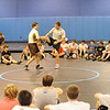 Lehigh College wrestling coach Pat Santoro (left) demonstrates a move with Lehigh wrestler Alex Caruso before a group attending the fourth day of Mahwah wreslting coach Dave Heitman's wrestling clinic at Ramapo Ridge Middle School.<br /> PHOTO: KELLY BIRDSEYE
