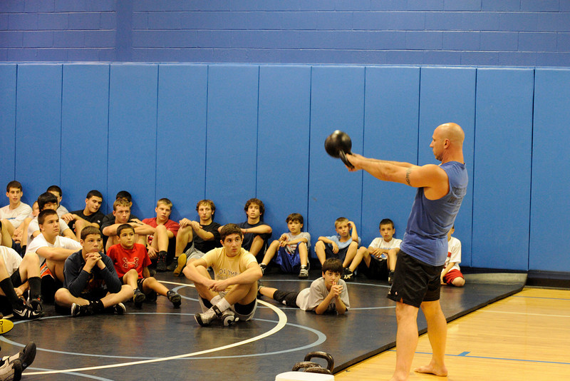Mahwah High School co-wrestling coach and certified RKC instructor (Russian Kettlebell Challenge) Phil Ross demonstrates the use of kettlebells for wrestlers who attended  the fourth day of Dave Heitman's wrestling instruction clinic by college wrestlers and coaches. On the fourth day, three Lehigh College coaches and three Lehigh College wrestlers were on hand to teach moves.<br /> PHOTO: KELLY BIRDSEYE