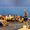 Mahwah High School co-wrestling coach and certified RKC instructor (Russian Kettlebell Challenge) Phil Ross during a kettlebell demonstration, talking to wrestlers who attended  the fourth day of Dave Heitman's instruction clinic by college wrestlers and coaches. On the fourth day, three Lehigh College coaches and three Lehigh College wrestlers were on hand to teach moves.<br /> PHOTO: KELLY BIRDSEYE