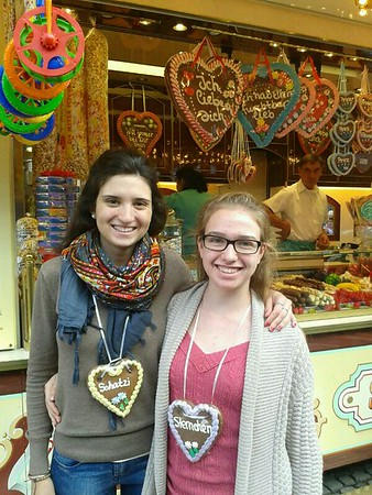 A high school foreign exchange student in Germany at a traditional German Christmas Market wearing a heart shaped cookie