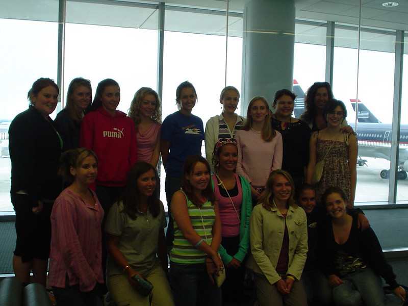 In the airport. Casey, back row, 4th from the left. Jamie is to her right.