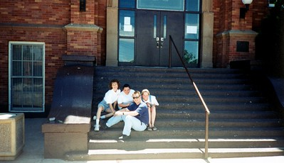 On the steps of the ol' high school.