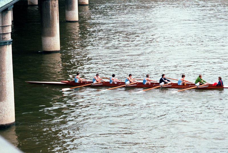 Crew team on the Seine, going under a bridge