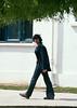 John striding along