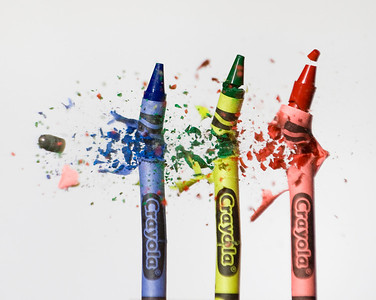 crayons being shot by a .22 caliber bullet.