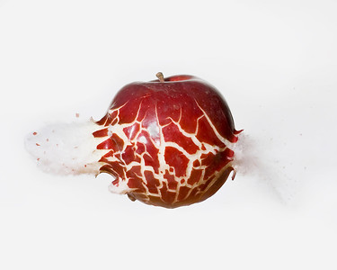 An apple being shot by a .22 caliber bullet.