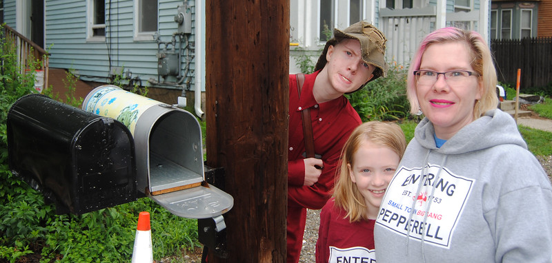 NASHOBA VALLEY VOICE/ANNE O'CONNOR<br /> High Street is getting redone with new drainage and sidewalks. The Campbells got a new mailbox and bracket as part of the deal. April Campbell with two of her children, Asher,13, and (-year-old Emmalyn.