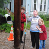 NASHOBA VALLEY VOICE/ANNE O'CONNOR<br /> High Street is getting redone with new drainage and sidewalks. The Campbells got a new mailbox and bracket as part of the deal. April Campbell holds the pole that workers removed when they tore out the sidewalk. Two of her children, Asher,13, and 9-year-old Emmalyn are with her.