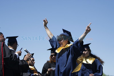 Bradley Berry cheers as they read his name at the Santa Fe High School graduation on Friday, May 26, 2017. Luis Sánchez Saturno/The New Mexican