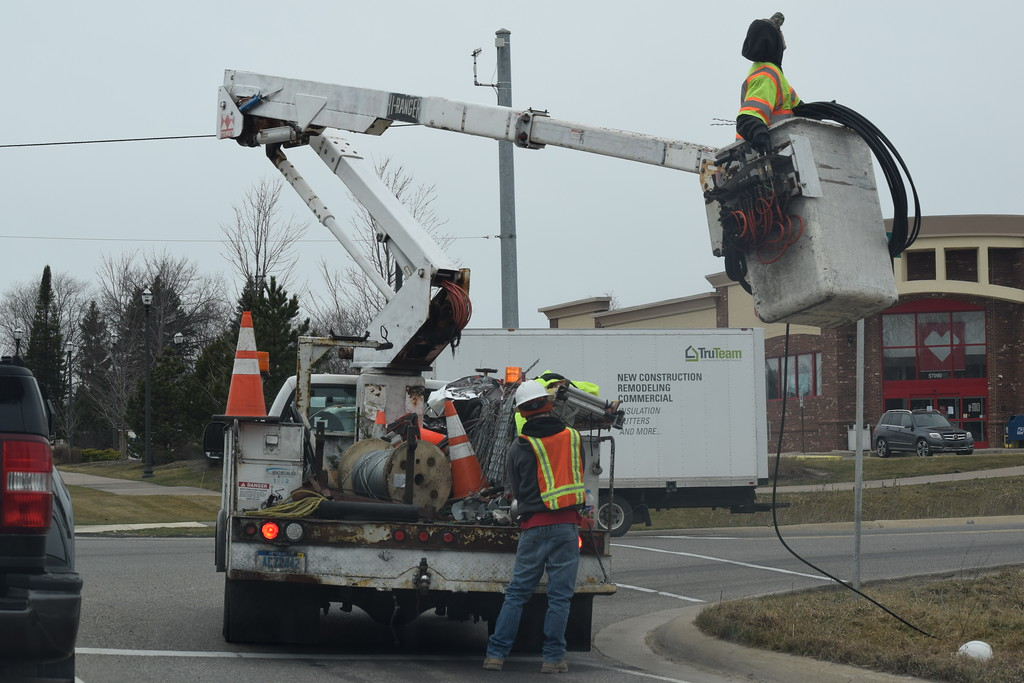 . Utility crews work to restore power in Lyon Township on Thursday, March, 9, 2017, at the corner of Milford Road and 10 Mile Road. (Mark Cavitt/The Oakland Press)