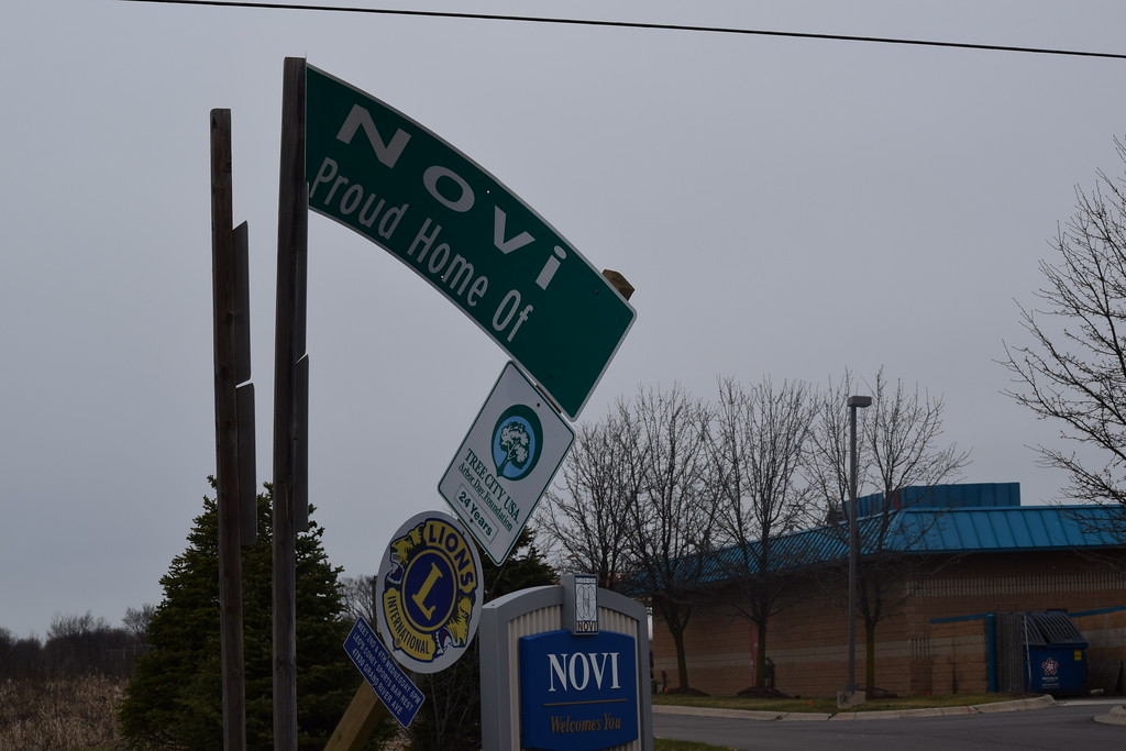 . High winds twisted a sign in Novi, Mich, at the corner of Wixom Road and Grand River Avenue. (Mark Cavitt/The Oakland Press)
