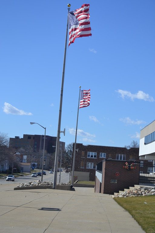 . Flags outside the former Pontiac Central High School are billowing in the wind.  Anne Runkle / Digital First Media