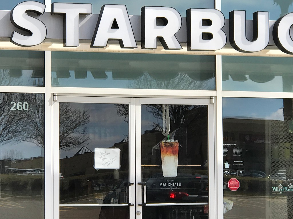 . Starbucks and Carson\'s were among the stores closed on Saturday at the Village of Rochester Hills. (Stephen Frye / The Oakland Press)