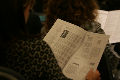 An audience member reviews the program