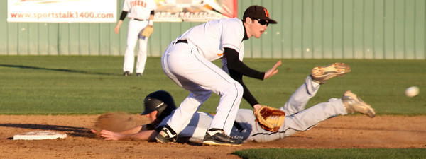 Tyler Bottoms slides to second in clash baseball