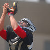 Team Ohio catcher Matt Smith snags a fly ball Wednesday afternoon during the team's game against Team Colorado during the Heartland Classic at Norman North.<br /> Kyle Phillips/The Transcript