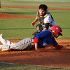 Arizona catcher (13) tries to get Texas' player out while sliding to home base on Tuesday. Julie Bragg/ The Transcript