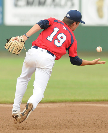 Team Oklahoma shortstop Donovan Walter tries to control a ground ball Thursday, June 21, 2012, during a game against Team Ohio in the Heartland Classic at Southmoore Field. Jerry Laizure / The Transcript
