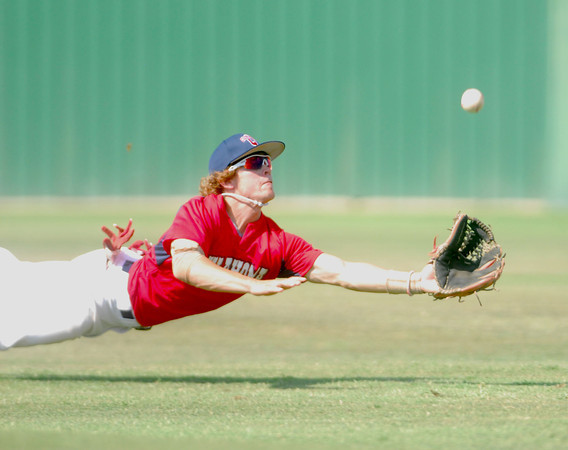 Team Oklahoma's Colt Pickens (23) makes a diving catch Saturday afternoon during the team's game against Team Texas at Norman High.<br /> Kyle Phillips/The Transcript
