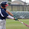 Team Ohio's Kirk Yates makes contact with the ball during his turn at bat during his team's game against Team Colorado during the Heartland Classic Wednesday afternoon at Norman North.<br /> Kyle Phillips/The Transcript