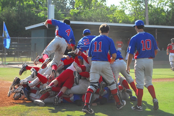 Team Texas celebrates their win over Team Oklahoma Saturday after the championship game of the Heartland Classic.<br /> Kyle Phillips/The Transcript