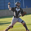 Norman North's Dalten Smith throws to first after picking up a bunted ball during the Timberwolves' game against Broken Aarow Friday, May 6, 2016. (Kyle Phillips / The Transcript)