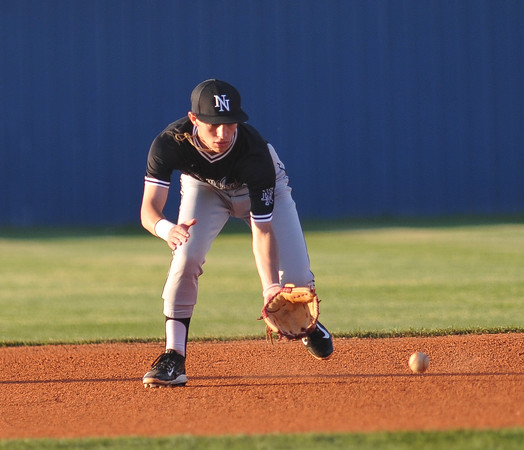 Norman North's Tristen Farrell picks up a grounder during the Timberwolves' game against Broken Aarow Friday, May 6, 2016. (Kyle Phillips / The Transcript)