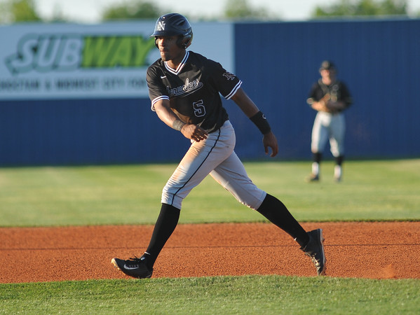 Norman North's Gaosh Williams leads off second during the Timberwolves' game against Broken Aarow Friday, May 6, 2016. (Kyle Phillips / The Transcript)
