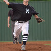 Norman North's Austin Cranford pitches the ball to a Southmoore batter duting the Timberwolves' game against Southmoore Friday night.<br /> Transcript photo by Kyle Phillips