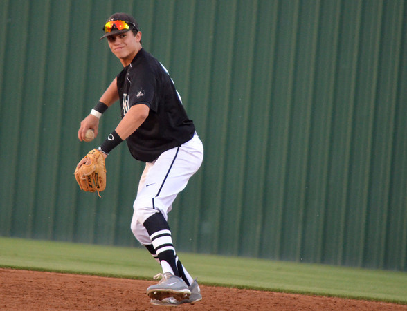 Norman North infielder D.J. Gasso throws the ball to first after picking up a ground ball Friday night during the Timberwolves' game against Southmoore.<br /> Transcript Photo by Kyle Phillips