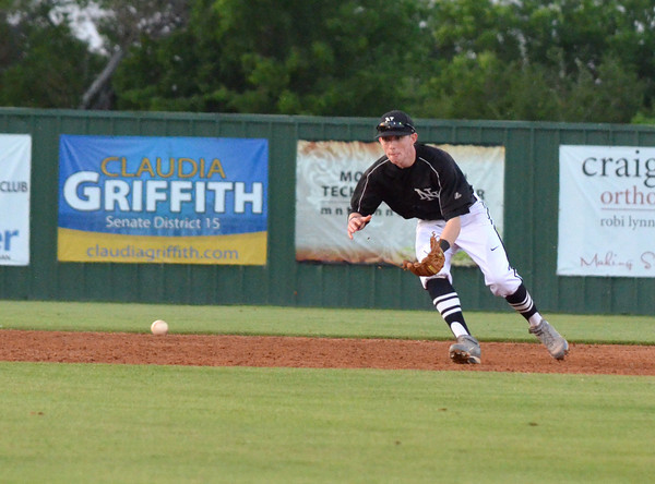 Norman North infielder Chase Kuwitzky gets ready to pick up a ground ball during the Timberwolves' game against Southmoore Friday night.<br /> Transcript Photo by Kyle Phillips