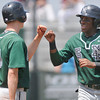 Norman North's Joe Nostrand (8) celebrates with Nick Basquine after scoring a run during the Timberwolves' game at Tull Lake Park Wednesday, May7, 2014.<br /> Kyle Phillips / The Transcript