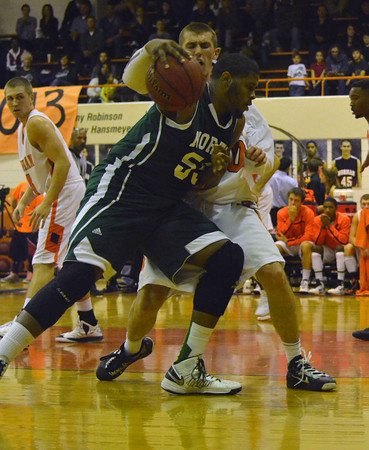 NOrman North's Kairo Rutledge pushes toward the goal during the Clash basketball game Friday night at NOrman High.<br /> Kyle Phillips/The Transcript