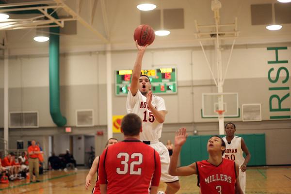 NHS boys basketball plays Yukon at Bishop McGuinness