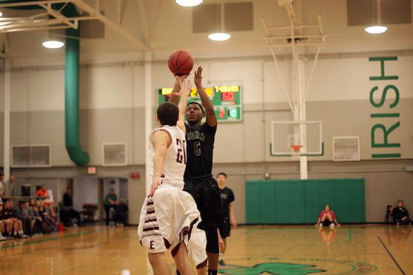 NN boys basketball plays Edmond Mem at Bishop McGuinness