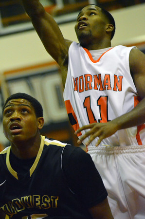 Norman High's Rico Hogan goes up for a shot during the Tigers' game against Midwest City Tuesday night at Norman High School.<br /> transcript Photo by Kyle Phillips