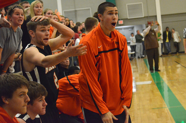 Players on the Norman High bench react to a call during the Tigers' loss against Bishop McGuiness Saturday night.<br /> Transcript Photo by Kyle Phillips