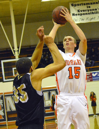 Norman High forward Conner Madole takes a shot during the Tigers' game against Midwest City Tuesday at Norman High School.<br /> Transcript Photo by Kyle Phillips