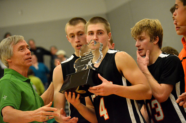 Norman High players accept the runner up trophy after their loss to Bishop McGuinness Saturday night at the Bishop McGuiness basketball tournament.<br /> Transcript Photo by Kyle Phillips