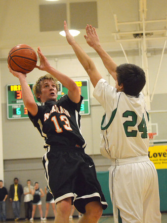 Norman high's Grant Ladner takes a shot  Saturday night at the Bishop McGuiness basketball tournament.<br /> Transcript Photo by Kyle Phillips