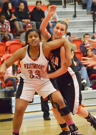 Westmoore's Kabria Harkey tries to keep Norman High's Taylor Ely from snatching a rebound Tuesday night as the Tigers take on the Jagaurs at Westmoore High School.<br /> Transcript Photo by Kyle Phillips