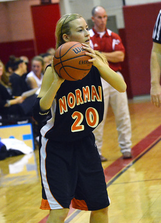 Norman High guard Mackenna Perkins looks for an open teammate to pass the ball to during the Tigers' loss to Durant Wednesday at the Del City Holiday Basketball Tournament.<br /> Transcript Photo by Kyle Phillips
