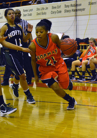 Norman High's Toni Greene drives toward the basket Friday night during the Tigers' win against Norman North during the Clash basketball game at NHS.<br /> Transcript Photo by Kyle Phillips