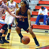 Norman High guard Toni Greene pushes toward the basket Thursday  during the Tigers' game at the Del City Holiday Basketball Tournament.<br /> Transcript Photo by Kyle Phillips