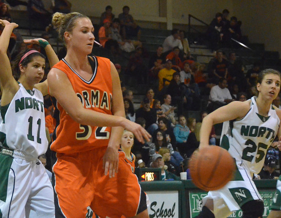 Norman High's Taylor Ely  passes the ball  Friday night during the Clash basketball game at Norman North.  The Tigers beat the Timberwolves' on a buzzer-beater shot in the final seconds of the game.<br /> Transcript Photo by Kyle Phillips